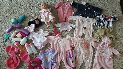 Baby born interactive doll bundle. It cries, kicks legs, wees!  Lots of clothes.