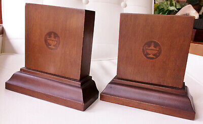 Very Nice Pair of Antique Wooden Book Ends with Inlaid Genie Lamp logo