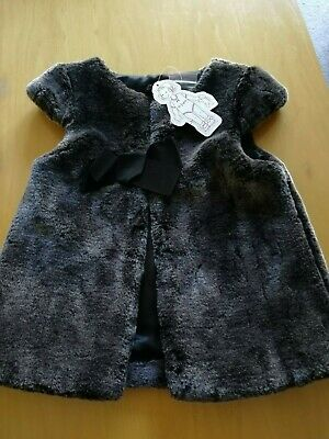 BNWT Lili Gaufrette fur gilet with bow at the front and cap sleeve age 5/6 yrs