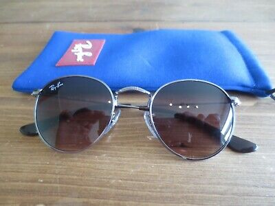 Ray Ban Junior silver round frame sunglasses. RJ 9547S. With bag.