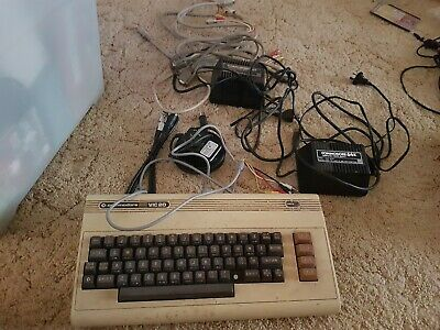 Commodore 64parts vic Computer and Power Supplies and cables untested