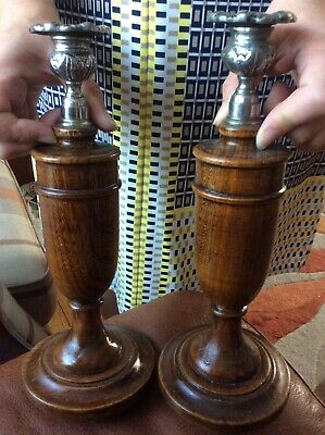 A Pair Of Wooden Candle Sticks.