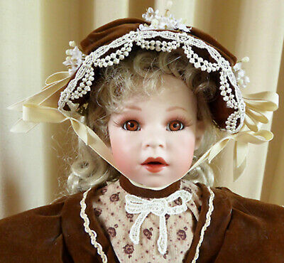 The Coca-Cola Company Porcelain Doll 1995 52 cm  with Stand and Rag Doll.