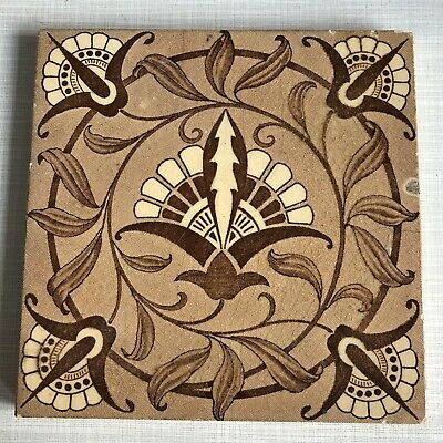 ANTIQUE SIX INCH TILE 19th CENTURY STYLISED SYMMETRICAL FLOWER DESIGN BROWNS