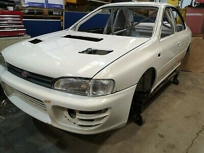 Subaru Impreza Rally Car shell with custom cages roll cage