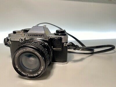 Olympus Om10 Camera with Lenses, Case and Manual Adapter