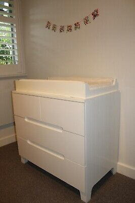 Bloom brand white baby drawers with change table attachment to sit on top.