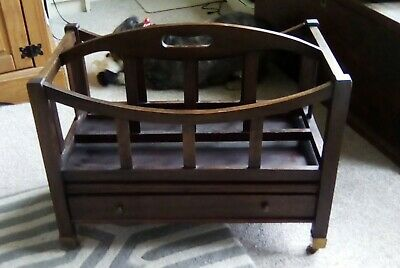 Antique Canterbury Magazine Rack. With drawer and bass casters