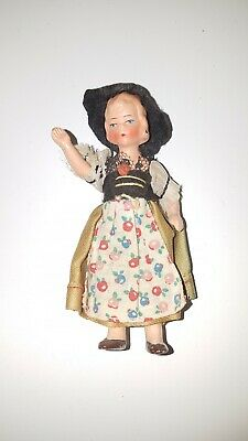 Antique, German, Dollhouse Doll, Bisque Girl in Flower Dress. 4 inches tall
