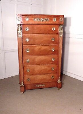 A Tall French Art Deco Walnut Chest of Drawers in the Neo Classical Style