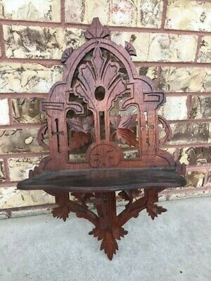Victorian style walnut wooden hanging shelf Church & leaf accents folding shelf