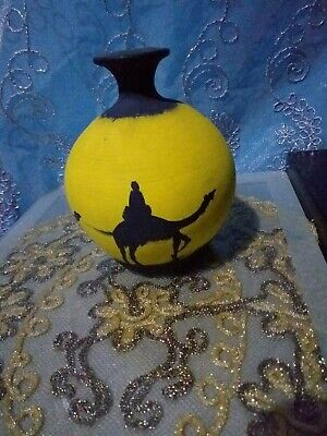 An Egyptian pottery vase made with a beautiful camel decree