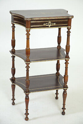 A three - tier vennered  and brass inlay etagere with jewelry storage .