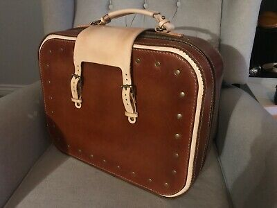 Handmade leather carry-on suitcase