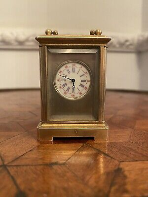 Miniature Porcelain Panel Carriage Clock Brass Case Cherub Gilt Decoration
