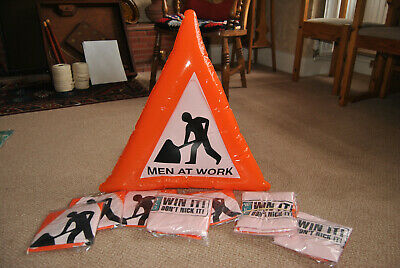 TWO New Inflatable WKD Men at work warning triangles.