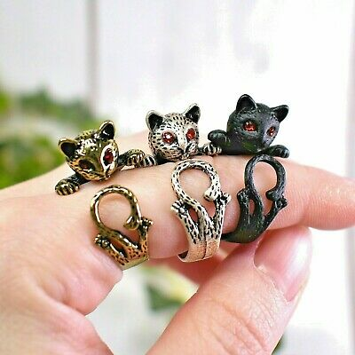 Cat Ring with Curly Tail and Red Rhinestone Eyes: Black, Silver, and Gold