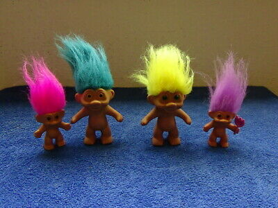 1991 TNT Troll dolls with fuzzy Hair and the small ones are by Russ