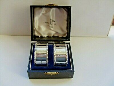 pair of silver napkin rings made by walker&hall sheffield 1954 in orig. box VGC