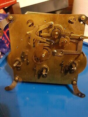 Antique clock mechanism with chiming  spares or repair