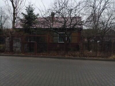An old house with a piece of land in central Poland