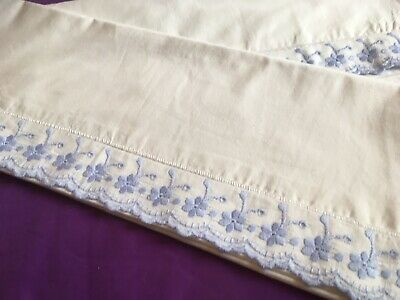 Pair of white cotton vintage pillowcases with a blue Broderie Anglaise type trim