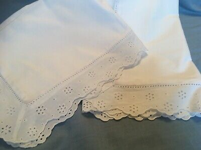 Pair of crisp white cotton pillowcases with a Broderie Anglaise Oxford edge