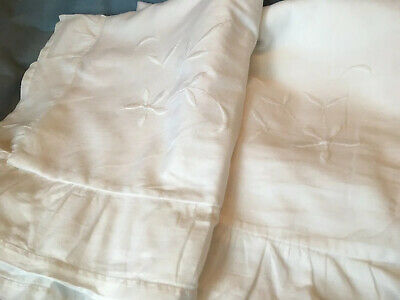 Very fine white cotton embroidered pillowcases with a frilly Oxford edge