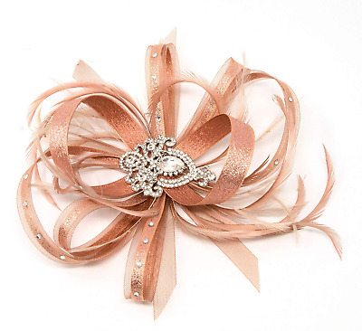 Shimmering metallic rose gold fascinator with diamante brooch. On a clip, comb