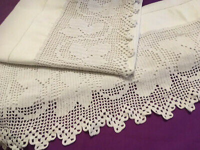 Pair of white cotton antique pillowcases with a handmade lace edged overhang
