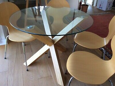 Table and Chairs. Glass topped table