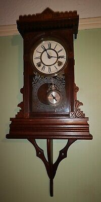 Antique Vintage Old waterbury clock Co Wall striking 8 Day clock in good working