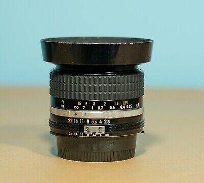 Nikon Nikkor 28mm F/2.8 AIS Lens. Smudges on Front Glass. Excellent Images.