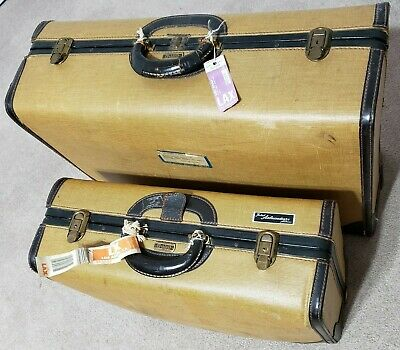 vintage Oshkosh two suitcases with vintage travel tags