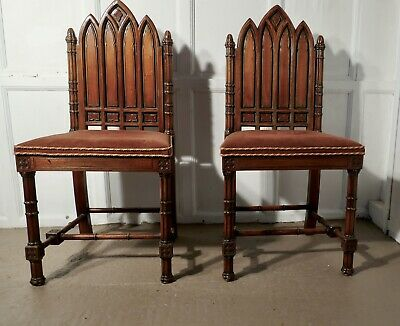 A Pair of Pugin Style Arts and Crafts Carved Oak Hall Chairs