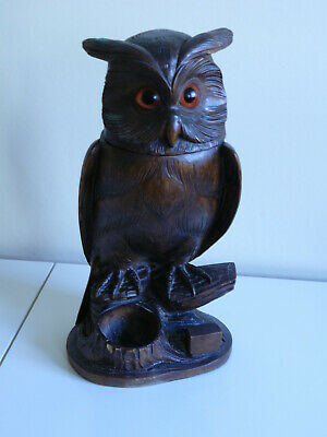 An early 20thC carved wood Black Forest tobacco jar in the form of an owl