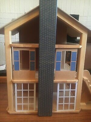 Wooden dolls house, with furniture