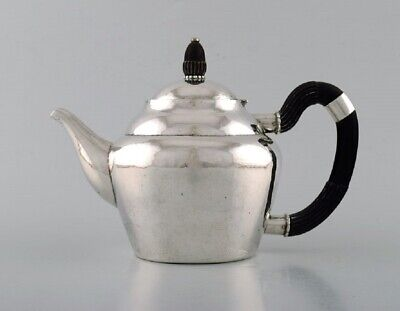 Early and rare Georg Jensen teapot in hammered silver with handle in ebony