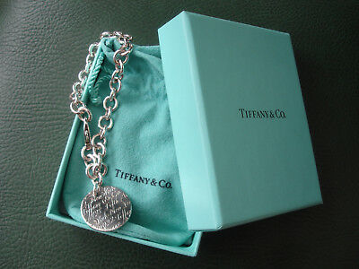 Authentic Tiffany & Co Sterling silver bracelet with Notes Script round pendant