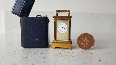 Good quality Fine Miniature travel Carriage clock in original blue leather case