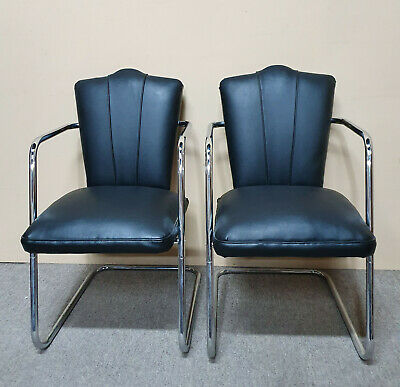 A Pair Of Art Deco Chrome Framed Upholstered Arm Chairs