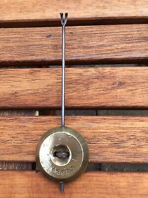 An Antique French Clock Pendulum Bob And Rod With Hook