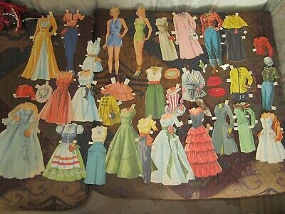 vintage paper dolls and  fashions