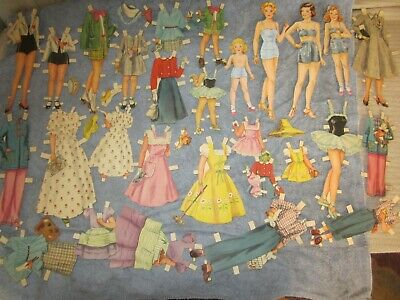 vintage of 4 paper dolls and  fashions
