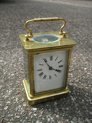 * original OLD CARRIAGE CLOCK in brass case c. 1900, used condition, working.
