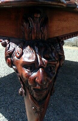 Large antique Chippendale style hand carved mahogany mask legged coffee table