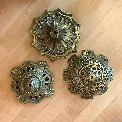 Three heavy-duty ornate and elegant vintage polished cast brass lamp bases