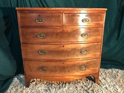 Regency bow front chest of drawers with splayed feet .