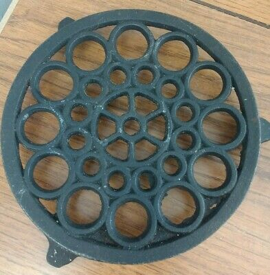 Vintage Pre owned black small cast iron Round trivet Made in Taiwan