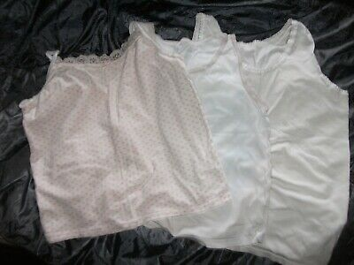3 child's vest tops, 2 x White, 1 x strappy with pink hearts Age 8-9